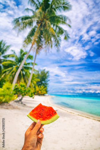 Staande foto Wanddecoratie met eigen foto Summer healthy eating woman holding watermelon taking food selfie on tropical beach vacation, Hawaii.