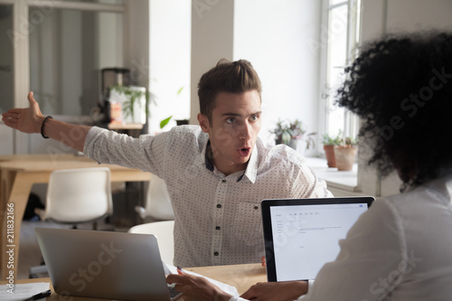 Mad male worker yelling at female colleague asking her to leave office, multirac Fototapet