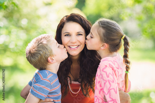 Staande foto Wanddecoratie met eigen foto Children Kissing Mother