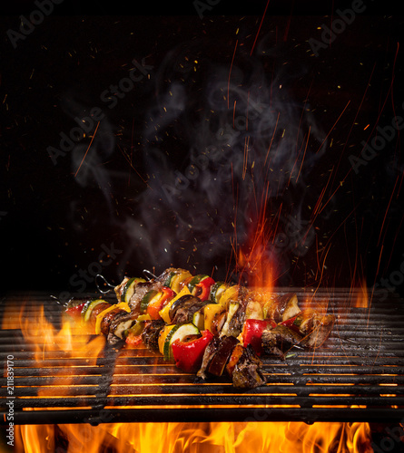 Aluminium Prints Grill / Barbecue Chicken skewers on the grill with flames