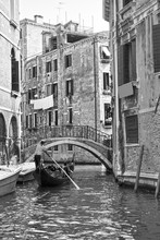 Venetian View With Small Canal With Gondola