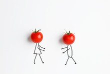 Tomatoes With Hand Drawing Shapes Of Couple In Love