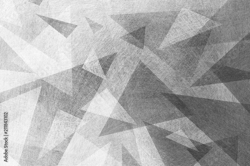 black and white background with abstract geometric design of gray layers of triangle and polygon shapes with texture