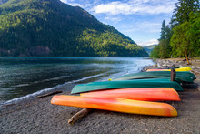 Row Of Colorful Kayaks Lying On The Shore Of Lake Crescent On Late Afternoon, Olympic National Park, Washington State, USA.