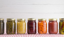 An Assortment Of Various Fruits And Vegetables That Have Been Canned At Home