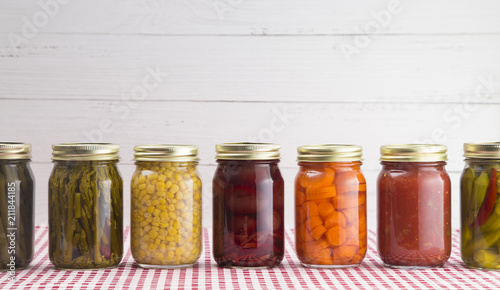 Fotomural  An Assortment of Various Fruits and Vegetables that have been Canned at Home