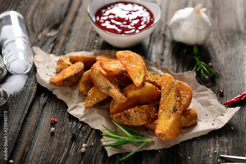 Potato wedges with herbs Fototapeta