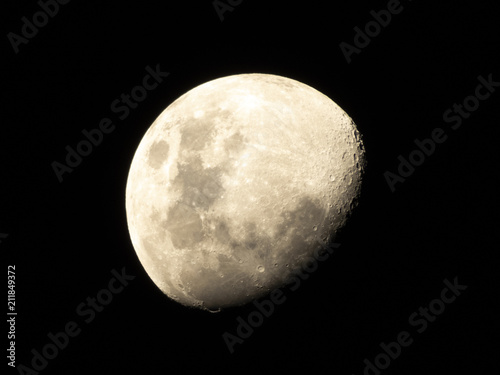 Half Moon, Crescent moon, gibbous moon in the middle of its way on the clear sky Poster