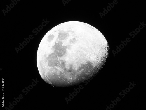 Half Moon, Crescent moon, gibbous moon in the middle of its way on the clear sky Plakát