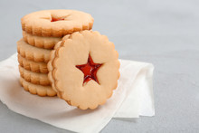 Traditional Christmas Linzer Cookies With Sweet Jam On Table