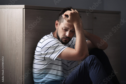 Valokuva  Lonely man suffering from depression at home