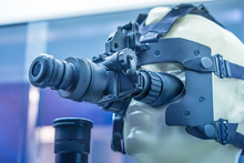 Night-vision Device. Helmet With Night Vision. A Standard Telescopic Sight Is Completed With A Night Sight In Front. Night Optical Observing Device. NVD