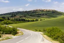 Tuscan Road Winding Through Green Fields Towards Pienza, Tuscany