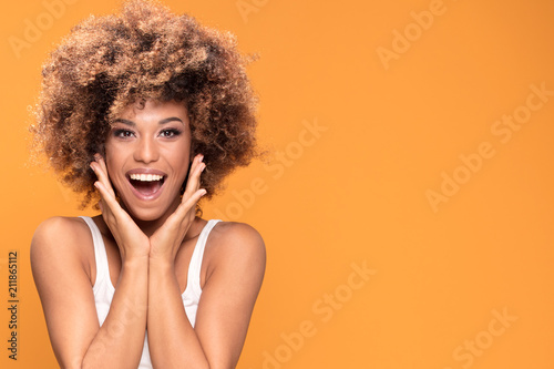 Fotografie, Obraz  Surprised amazed beautiful afro woman with wide open smiling mouth