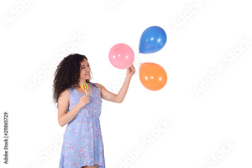 Fototapeta Beautiful Woman with sweet lollipop and baloons.