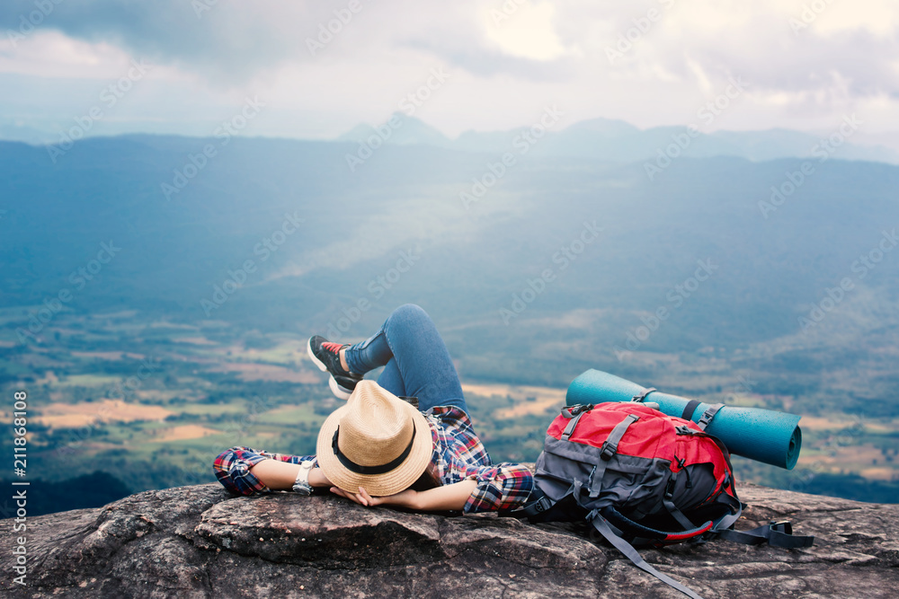 Fototapeta Happy Asian woman relaxing on holiday  travel concept,selective and soft focus,tone of hipster style