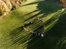 Wedding Guests Lined Up In The Shape Of Heart With Bride And Groom Marriage People