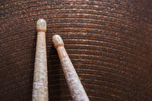 Pair Of Drumsticks Lying On Cymbal.