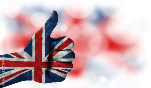 Photo  hand thumbs up, flag of United Kingdom.
