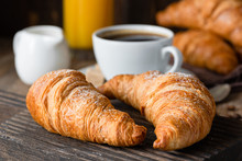Croissants, Coffee And Orange Juice. Continental Breakfast. Closeup View