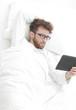 background image . modern man reading on digital tablet.