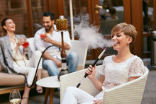 People Smoking Shisha, Drinkin...