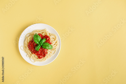 Spaghetti pasta on yellow background