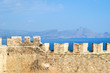 The wall of the old fortress against the sea