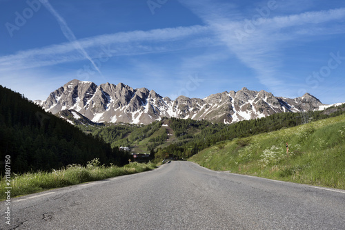 Fotografie, Obraz  road and snow capped mountains in parc mercantour neaqr col de vars in the frenc