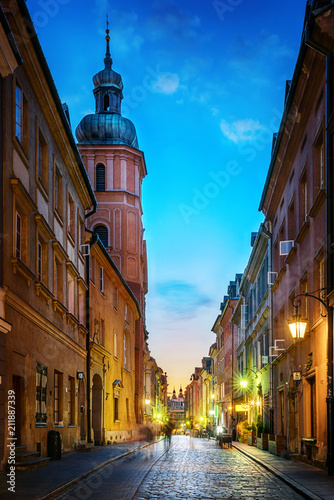 Warsaw old town street. Evening view of old houses and Church. Long exposure. Warsaw, Poland.