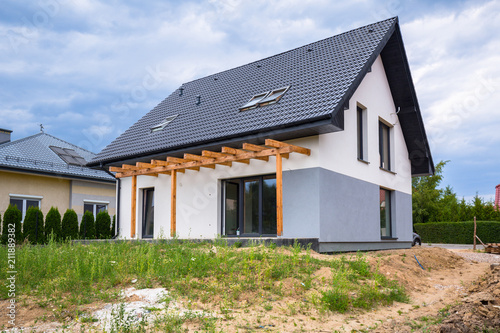 Photographie Newly built house with a finished plaster and paint
