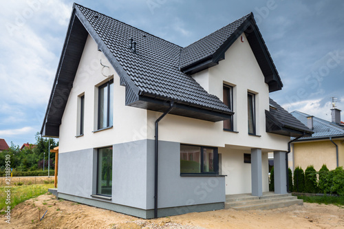 Newly built house with a finished plaster and paint - fototapety na wymiar