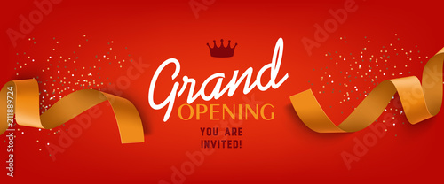 Fotografia Grand opening red banner design with gold ribbon, crown and confetti