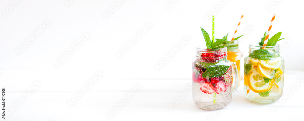 Fototapeta Homemade iced lemonade with mint, summer fruits and berries in a mason jar. Copy space background