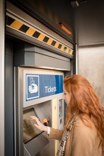 Woman Using Automatic Vending ...