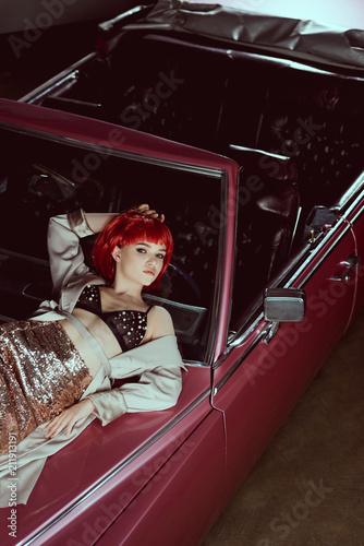 high angle view of beautiful stylish girl lying on vintage