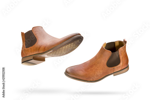 Photo  Brown Chelsea boots floating isolated on a pure white background with a shadow