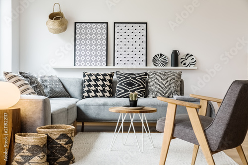 Marvelous Real Photo Of A Small Table Standing Between A Sofa With Gmtry Best Dining Table And Chair Ideas Images Gmtryco