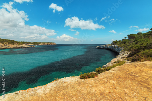 Papiers peints Cote Cala Mondrago natural park landscape view. Beautiful cove with turquoise crystal waters in Cala s'Amarador Mediterranean Sea. Travel concept.