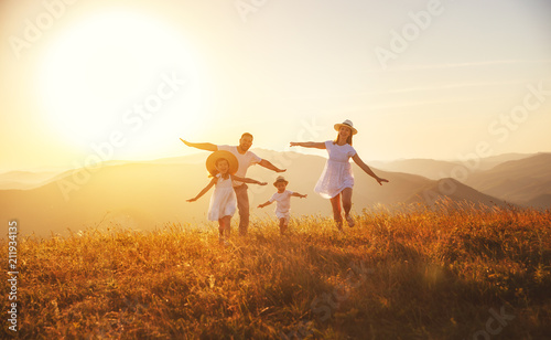 Staande foto Wanddecoratie met eigen foto Happy family: mother, father, children son and daughter on sunset