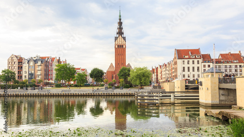 Old Town in Elblag with dominant tower of St. Nicholas church seen from other bank of Elblag River