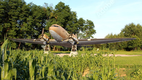 Photo  Front view of Douglas Dakota DC-3 C-47 WWII plane situated in local forest as ex