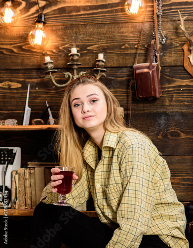 Fotografie, Obraz Girl in casual outfit sits in wooden vintage interior