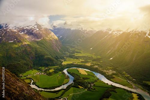 River meanders around fields seen from Romsdalseggen ridge, Andalsnes, Norway