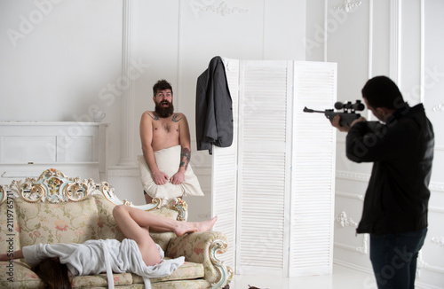 Leinwand Poster Aggressive man with gun to shoot couple in love