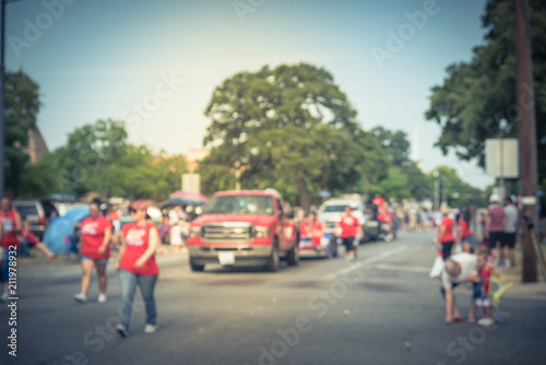Fotografia, Obraz Vintage blurred traditional July 4th parade in Irving, Texas, USA