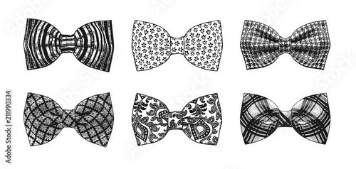Fotografiet The monochrome set of stylish bow ties on a white background