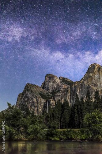Fotografiet  Bridal Veil Falls and Milky Way - Yosemite National Park, California, USA