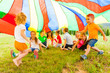 canvas print picture Cheerful kids hiding under rainbow canopy