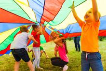 Close Up View Of Children Under The Huge Rainbow Cover